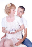 Young couple expecting a baby. Studio shot of young couple expecting a baby Stock Images