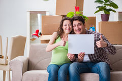 The young couple expecting baby with blank message Stock Photography