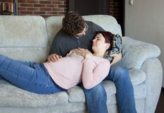 A young couple is expecting a baby stock photos
