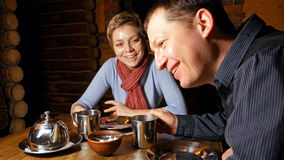 Young couple expressively chatting in a cafe. Young couple men and women expressively talking and chatting in a cafe restaurant Stock Photo