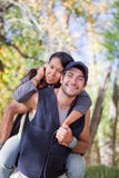 Young couple in fall forest Stock Photos