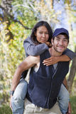Young couple in fall forest Royalty Free Stock Images