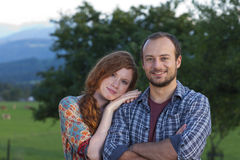 Young couple on a farm Stock Photos