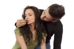 Young couple feeding each other chocolate Royalty Free Stock Images