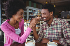 Young couple feeding each other Stock Photos