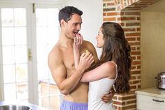 Young couple feeding fruits to each other Stock Photography