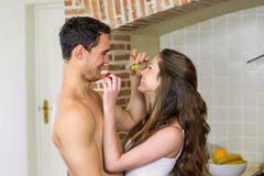 Young couple feeding fruits to each other Royalty Free Stock Photos