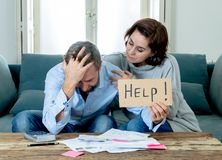 Young Couple Feeling sad and stressed paying bills debts mortgage having financial problems stock photography
