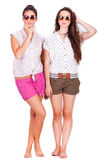 Young couple female friends laughing on white Royalty Free Stock Images