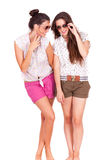 Young couple female friends laughing on white Royalty Free Stock Photography