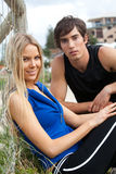 Young Couple By Fence Royalty Free Stock Photos