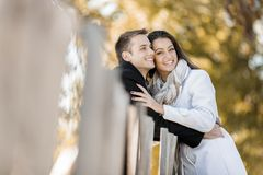 Young couple by the fence Royalty Free Stock Photos