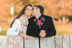 Young couple by the fence Royalty Free Stock Image