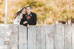 Young couple by the fence Royalty Free Stock Images