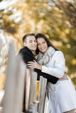 Young couple by the fence Stock Images