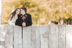 Young couple by the fence Stock Photography