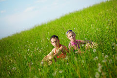 Young couple on the field Royalty Free Stock Photos