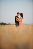 Young couple in the field. Young couple in wheat field Royalty Free Stock Photo