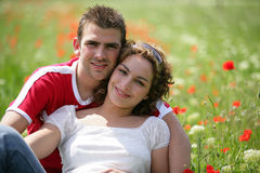 Young couple in a field Royalty Free Stock Image