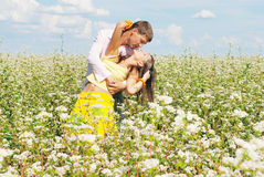 Young couple on field of flowers. Young couple on field of fresh flowers Stock Photography