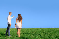 Young couple on field stock photography