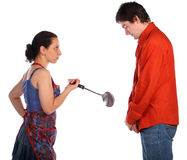 Young couple fight with ladle Royalty Free Stock Photo
