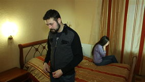 Young couple fighting, arguing in bedroom at night. Family relationships stock video footage