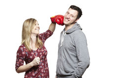 Young couple fighting with boxing gloves smiling Royalty Free Stock Image