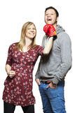 Young couple fighting with boxing gloves smiling stock image