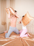 Young couple fighting pillows Royalty Free Stock Photo