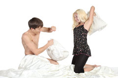 Young couple fighting pillows in the bedroom Stock Photography