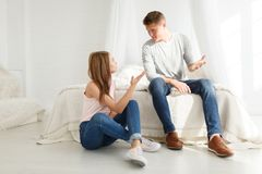 Young couple find out the relationship in the bedroom. Indoors bedroom. royalty free stock photos