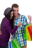 Young couple finding something while shopping Royalty Free Stock Photography