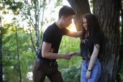 Young couple on the first date. In the city park Royalty Free Stock Images