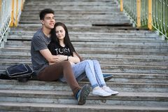 Young couple on the first date. In the city park Stock Images