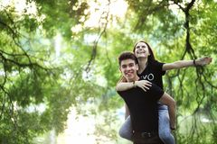 Young couple on the first date. In the city parkr Royalty Free Stock Photo