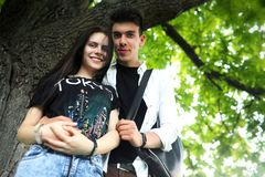 Young couple on the first date. In the city parkr Royalty Free Stock Image