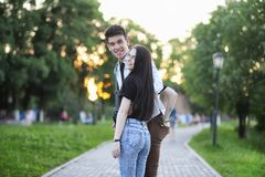Young couple on the first date. In the city park Royalty Free Stock Image