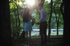 Young couple on the first date. In the city park Stock Photo