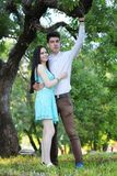 Young couple on the first date. In the city park Royalty Free Stock Photography