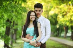 Young couple on the first date. In the city park Stock Photos