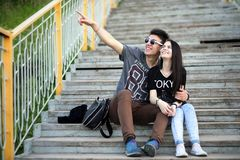 Young couple on the first date. In the city parkr Stock Photos