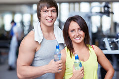 At the fitness club. Young couple at the fitness club Royalty Free Stock Photo