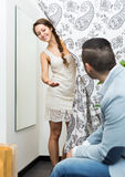 Young couple at fitting room Royalty Free Stock Image