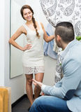 Young couple at fitting room Royalty Free Stock Images