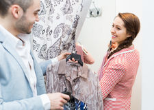 Young couple at fitting room Royalty Free Stock Photography