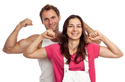Young couple flexing biceps Royalty Free Stock Photos