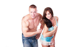 Young couple flexing their muscles Stock Photo