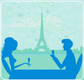Couple flirt and drink champagne in Paris Royalty Free Stock Photos