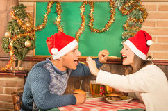 Young Couple flirting with american food at Christmas Dinner royalty free stock photos